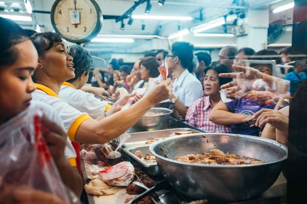 """1. Quiapo street markets sell toys, clothes, and fruits during the holiday season. / 2. People buy Chinese ham at the famous """"Excelente"""" store on Christmas eve."""