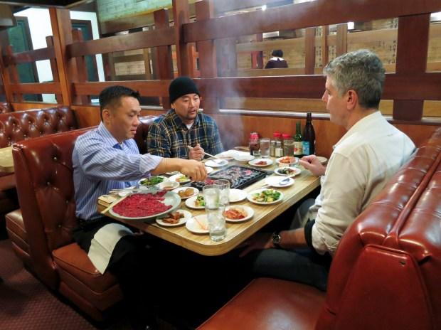 Anthony Bourdain, Roy Kim, and Roy Choi eating bulgogi and banchan at Dong Il Jang.