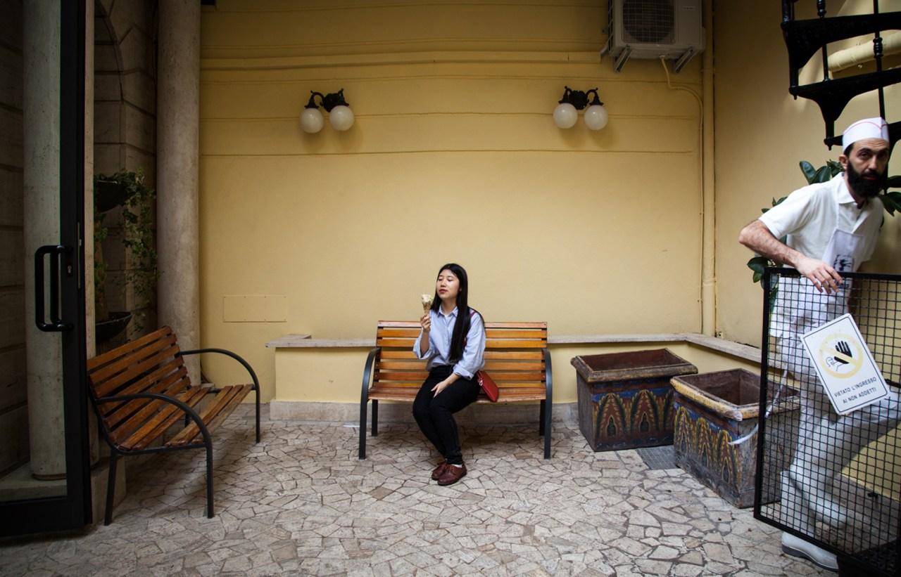 Lilia Meng eats a gelato in the yard of Fassi, a famous gelato store near Piazza Vittorio.