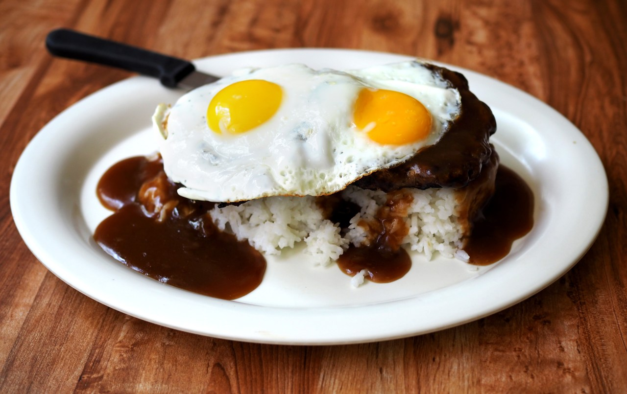 Loco moco: eggs sunny side up, beef patties, rice, and gravy.