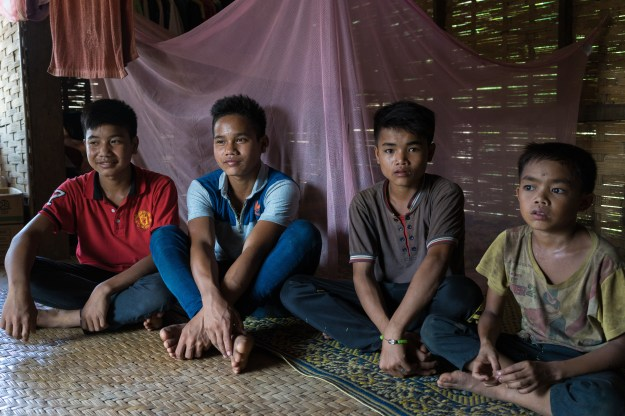 1. A group photo of the boys who were injured: Luu, Ty, Ming, and Mae. / 2. Luu shows the scars on his abdomen caused by the cluster bomb explosion.