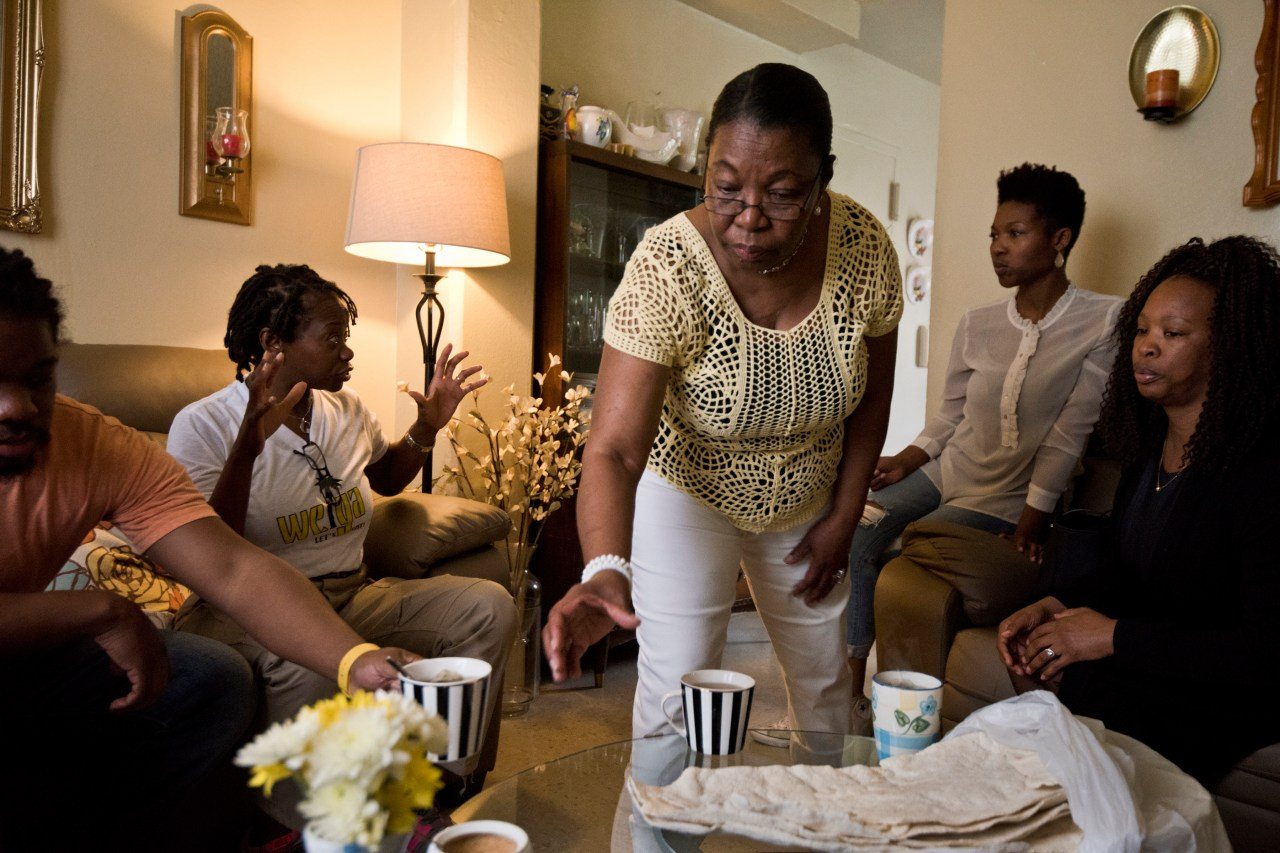 Sara Martinez serves white Casabe, a traditional yucca cake, in her Queens apartment.