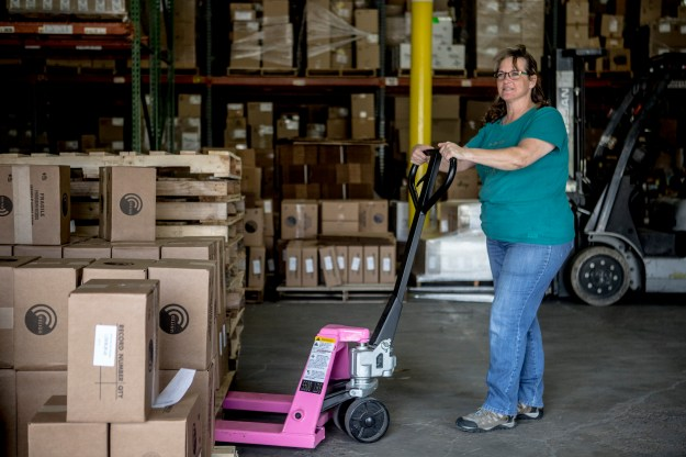 1. Donnie Morris, a print shop employee, has been working with the company for 17 years. / 2. Claudette Bird, a shipping clerk, in the warehouse.