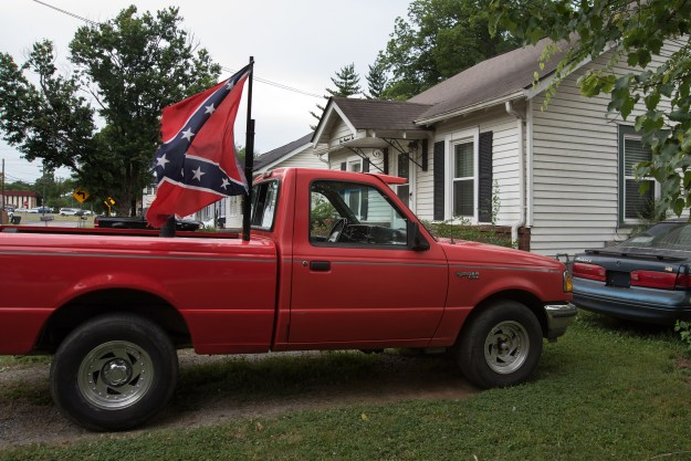 A truck parked in the driveway of a home and a yard sign in Murfreeesboro.