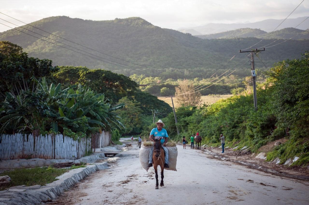 A cowboy makes his way uphill into Trinidad, a town in central Cuba.