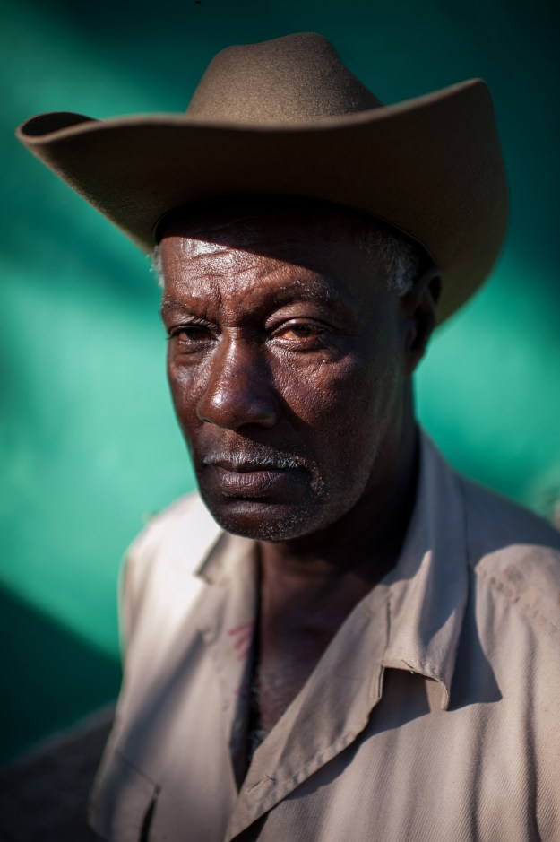 1. A cowboy from Viñales poses for a portrait while having his morning coffee, rum, and cigar. / 2. Ismael Gavilan, a cowboy and pig farmer living in Viñales.