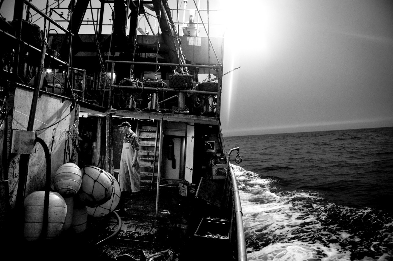 Deckhand Kenny prepares to set out the fishing line.