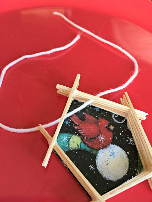 Kids' DIY Christmas Tree Ornament, yarn threaded