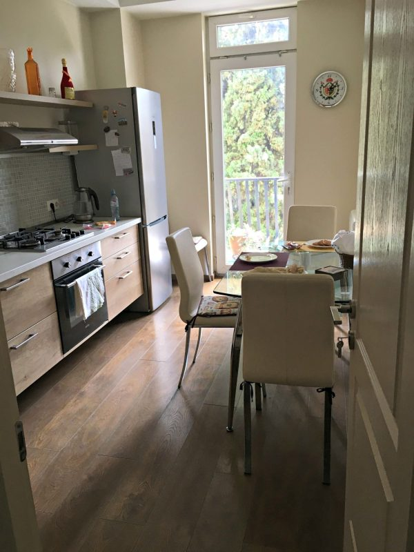 Tbilisi Airbnb kitchen with light from glass door balcony