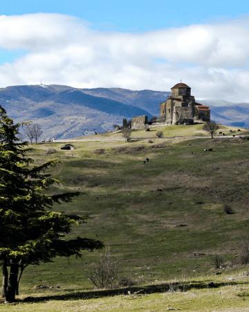 Jvari Church on top of the grassy hill