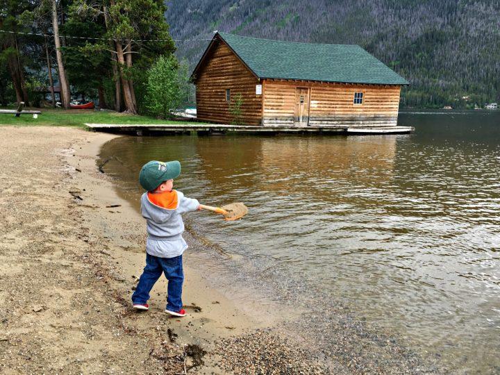 Shoveling sand in Grand Lake