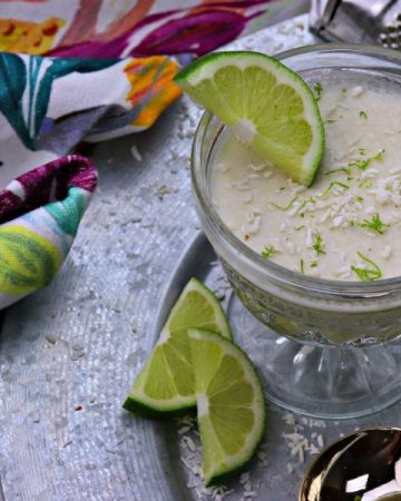Coconut lime dessert mousse with lime slices and tea towel