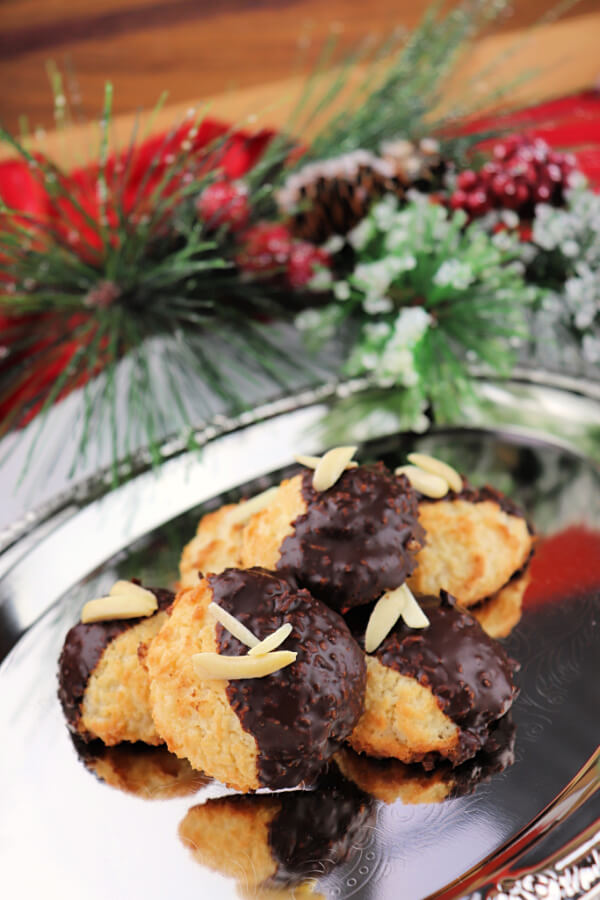Keto coconut macaroons are low carb holiday delights. Coconut, almonds, and chocolate make a fabulous gluten-free holiday recipe. #ketocookies #ketochristmas