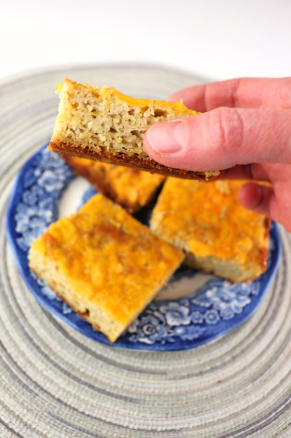 Keto cheddar focaccia, holding up a piece. #ketorecipes #lowcarbdiet