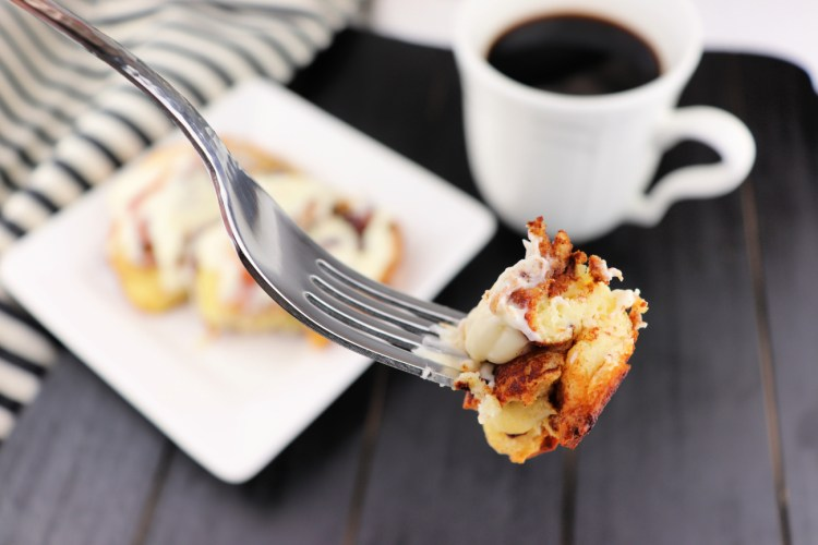 A bite on a keto cinnamon roll on a fork