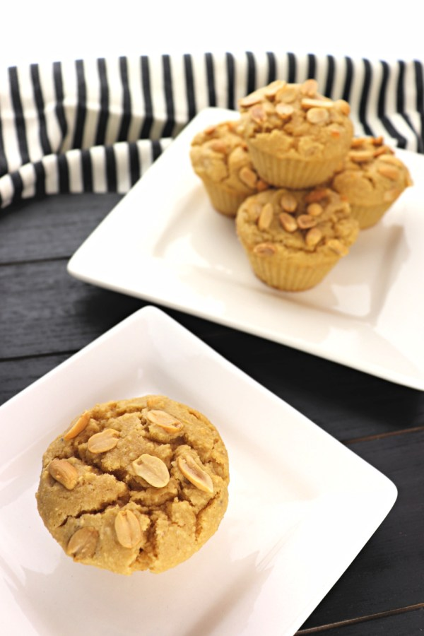 Plates of low carb peanut butter muffins are a welcome keto breakfast or lunch treat! Filled with a silky peanut butter cream cheese filling, they may become a new obsession. #lowcarbrecipes #ketobreakfast
