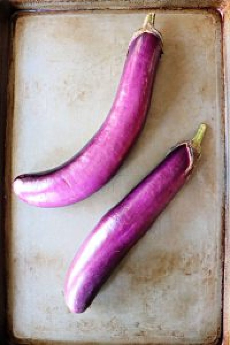 Two Chinese eggplants on a pan