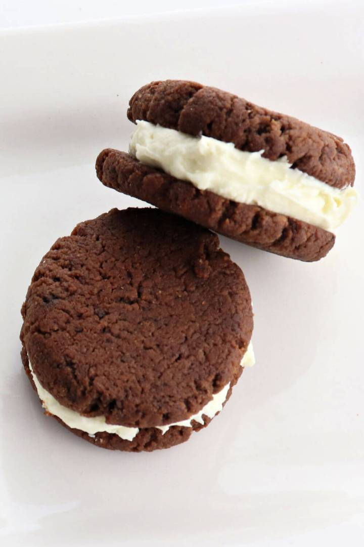 Low carb keto chocolate sandwich cookies on a plate are the perfect gluten-free snack. A cross between a keto oreo and a keto whoopie pie, these sugar-free treats are a family favorite. #ketorecipes #ketocookies