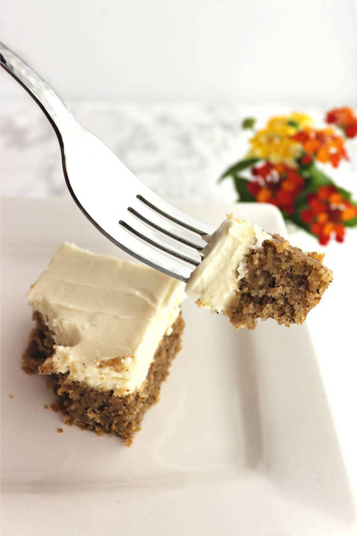Take a bit of creamy keto spice cake. Packed with spices while gluten-free, sugar-free, and perfect as a low carb dessert. Topped with dreamy cream cheese frosting, delicious. #glutenfreecake #spicecake #ketocake