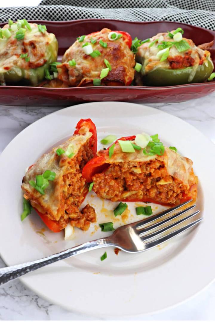 Low carb sausage stuffed pepper cut in half #lowcarbdinner #ketorecipes