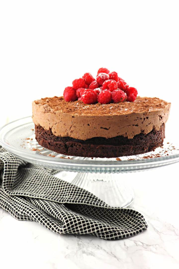 If you love chocolate, this keto chocolate mousse cake is rich and fabulously sugar-free chocolatey. The perfect low carb special occasion cake for Christmas, Valentine's Day or any holiday! #ketocake #ketochocolaterecipes #ketorecipes