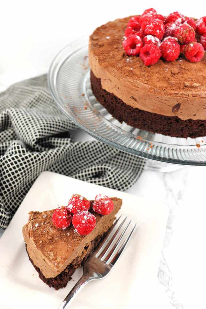 Piece of keto chocolate mousse cake. Gluten-free, sugar-free and super-chocolatey! Perfect for holidays or special occasions. #ketocake #ketodesserts