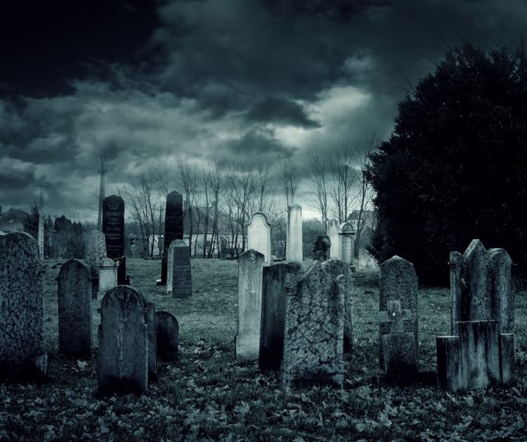 old cemetery at night in the moonlight makes a haunted place in Georgia
