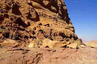 The Valley of the Moon in the vast Desert of Wadi Rum Jordan - A canyon with a mountain in the background - Geology