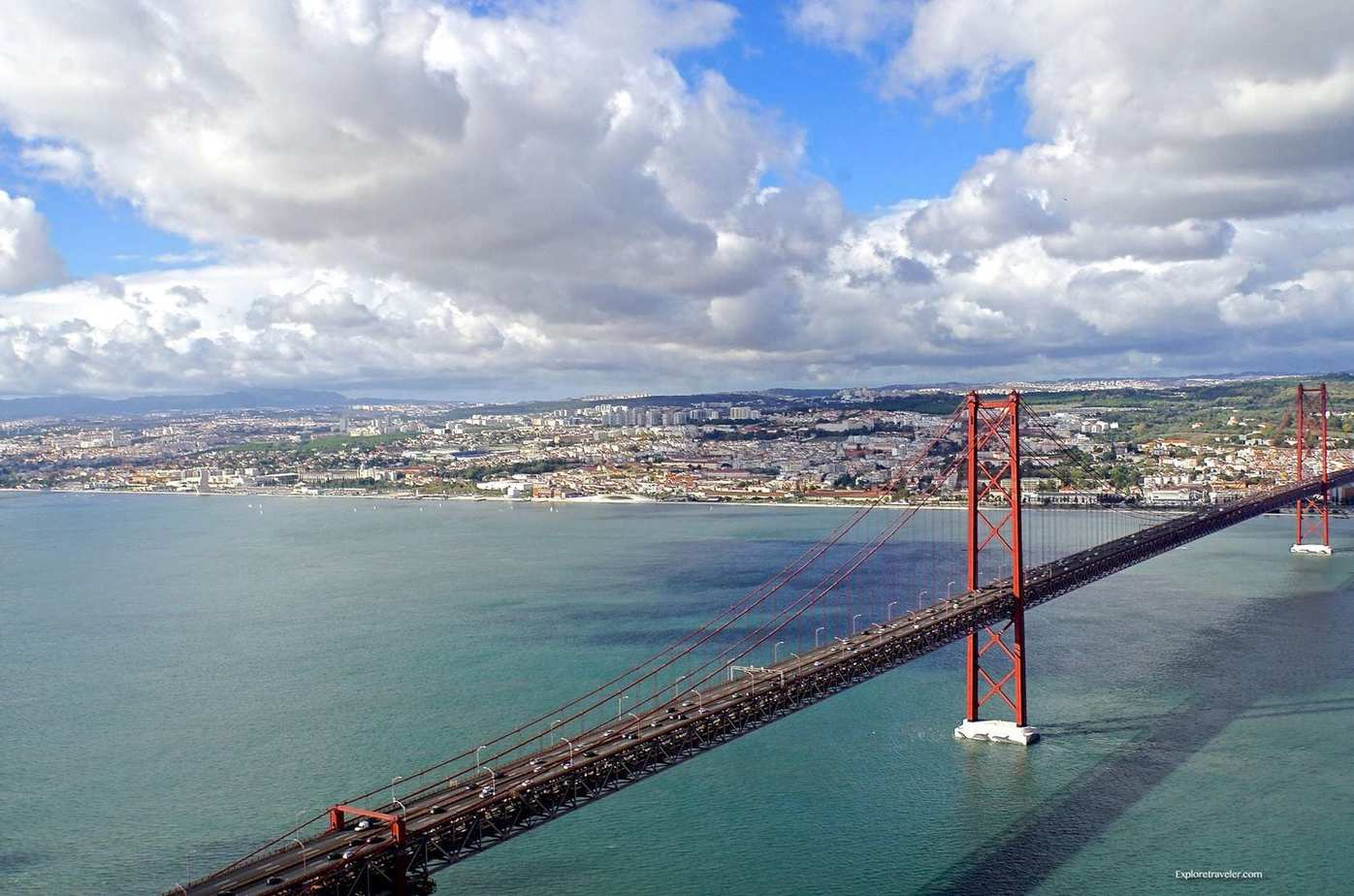 ExploreTraveler Presents: Exploring Lisbon Portugal Part 1 - A bridge over a body of water - Ponte 25 de Abril