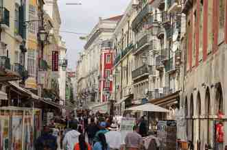 Lisbon The Stunning Capital City Of Portugal - A group of people walking on a city street - Urban area