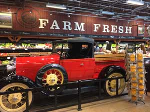 a bright red model t truck on display at Chucks Grocery