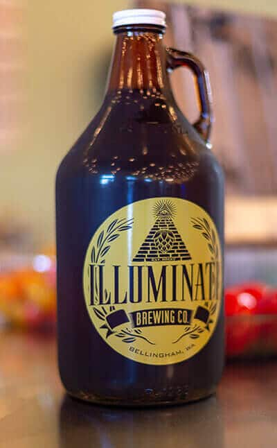 Growler of beer from Masquerade Wine Company and Illuminati Brewing
