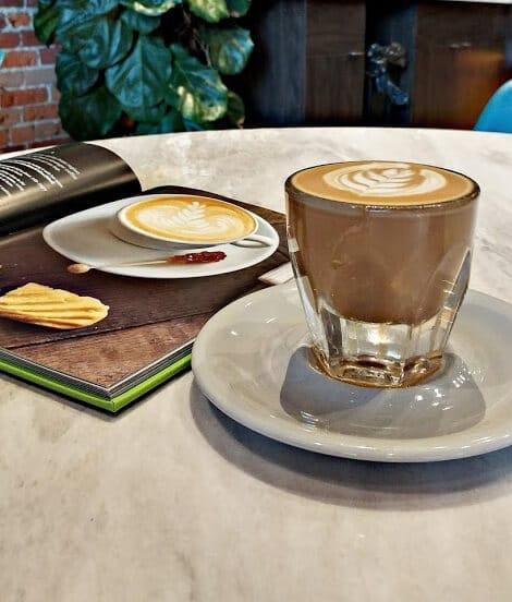 Indaba Coffee Roasters Spokane Coffee on saucer on marble table.