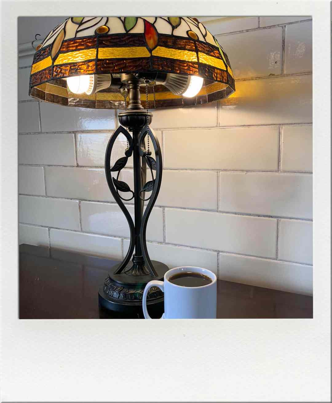 Northtown Coffeehouse Cup of coffee with stained glass lamp