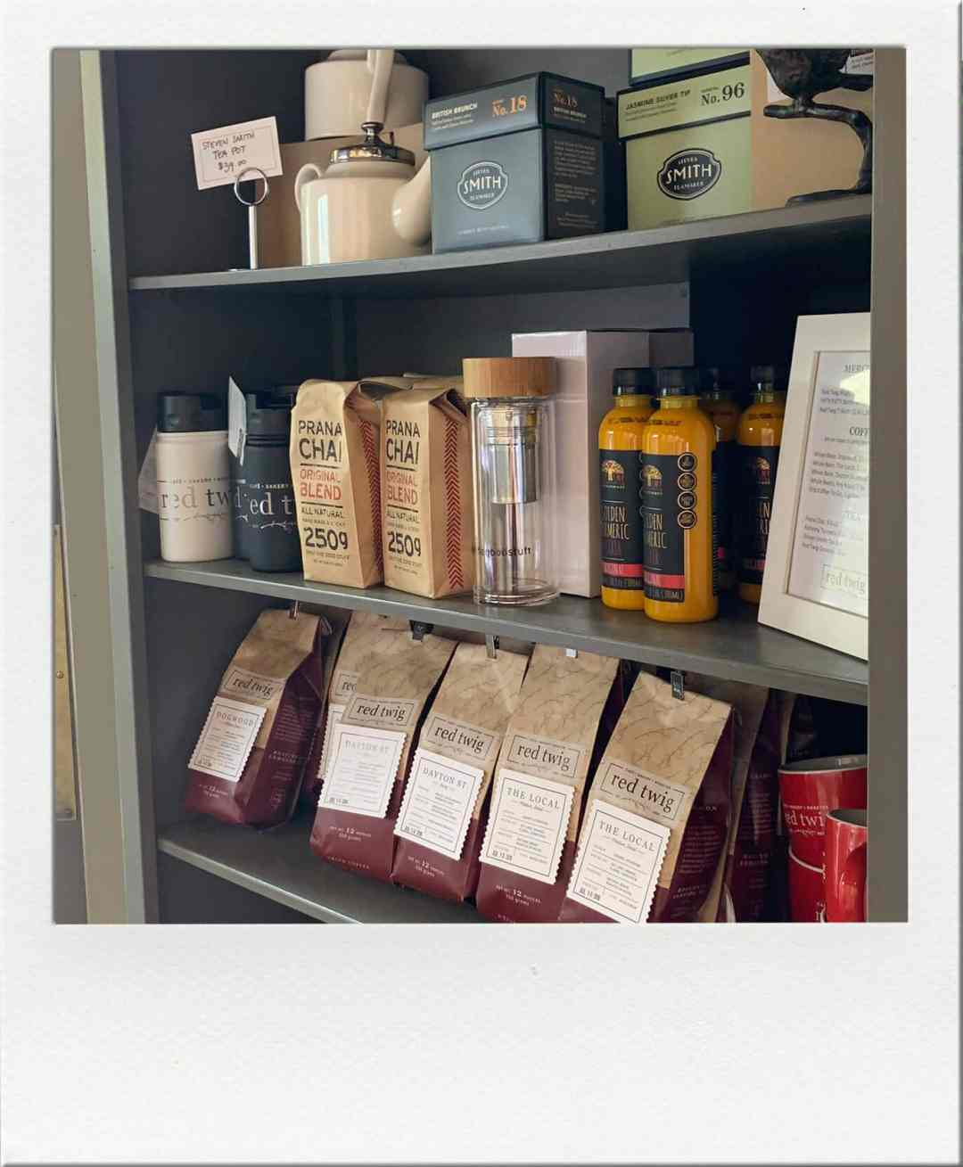 Coffee and teas for sale on shelves at red twig Edmonds Washington