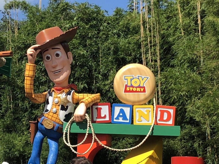 Talking Woody figure standing at the entrance of Toy Story Land in Walt Disney World's Hollywood Studios.