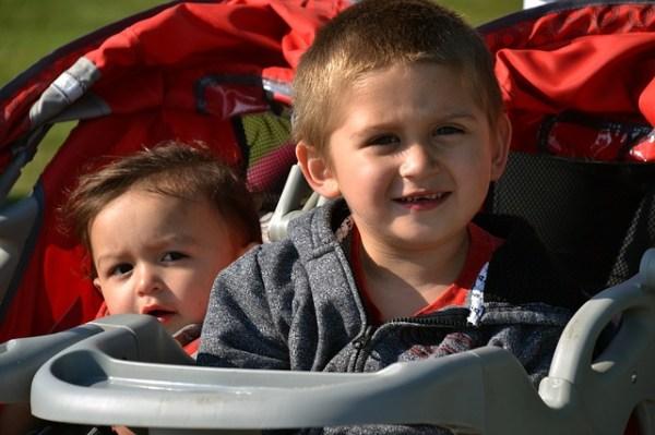LIttle kids enjoying their double stroller