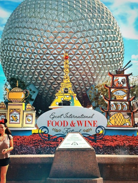Epcot International Food and Wine Festival sign in front of Spaceship Earth