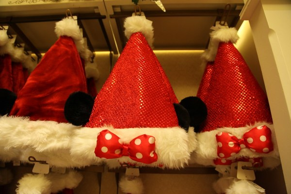 Minnie Mouse Santa Hats hanging in a Christmas Display