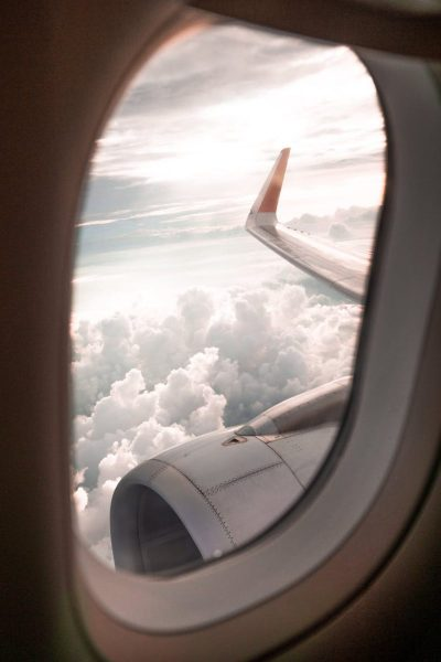 Looking out the window while riding in an airplane