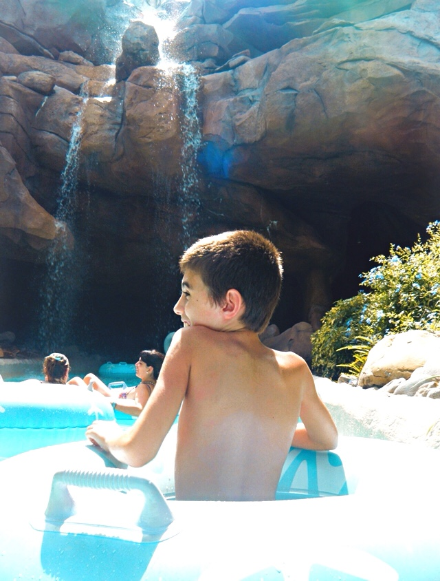 Boy riding in a tube in Disney's Typhoon Lagoon