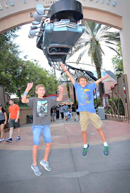 Jumping for joy at Disney's Hollywood Studios, in front of the sign for Rock 'n' Roller Coaster
