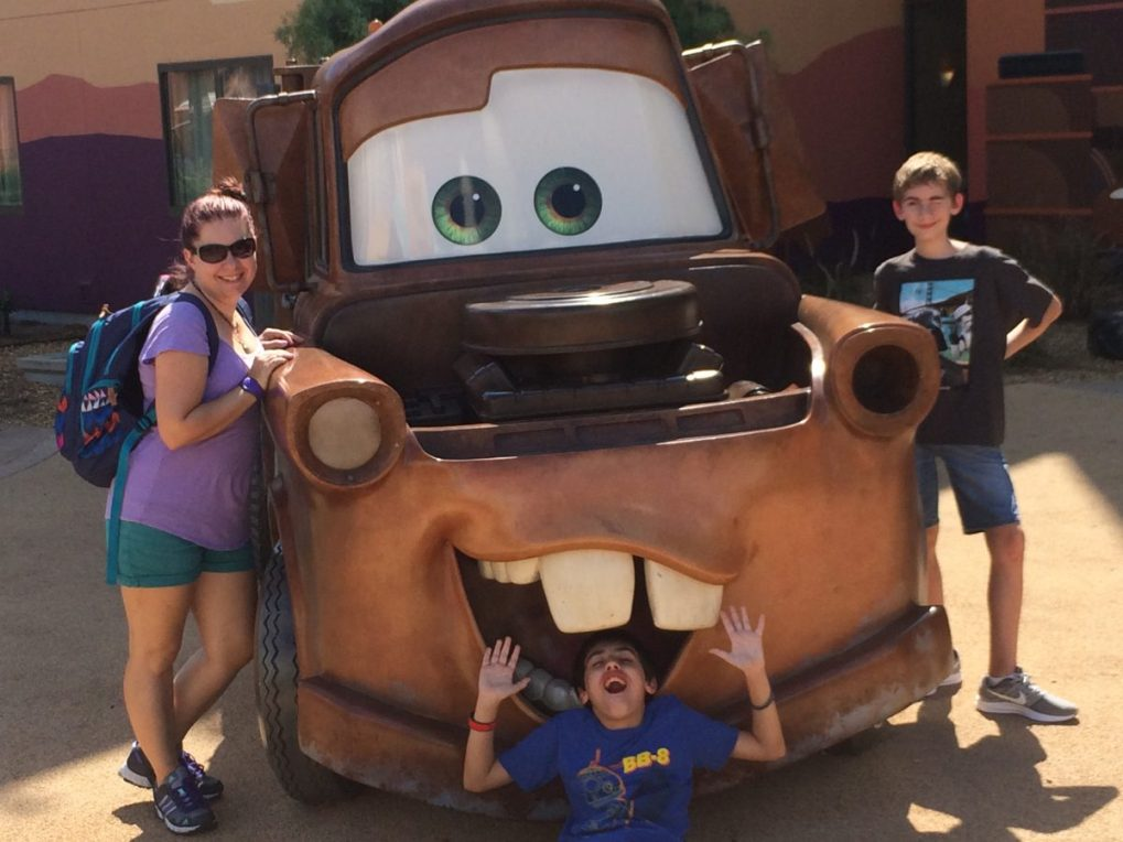 Posing with Mater from Cars at Disney's Art of Animation in Walt Disney World