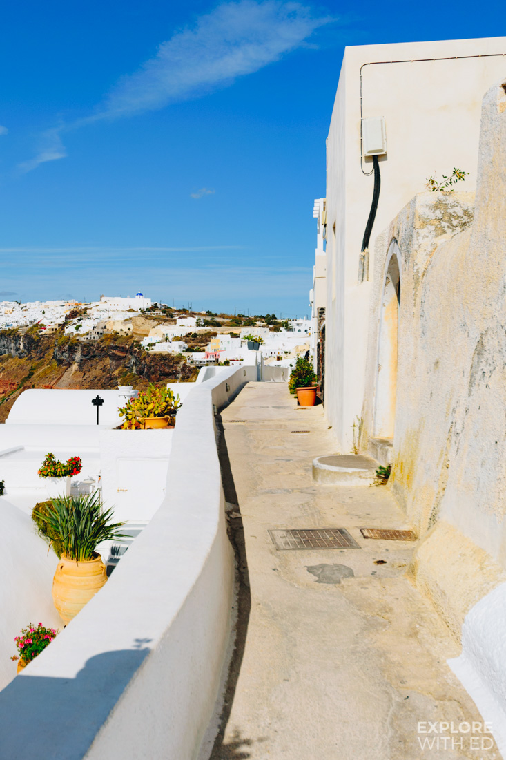 The narrow cliff top walk in Santorini past boutique hotels and apartments