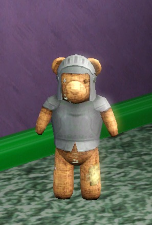 A well-loved teddy bear wearing cloth armor