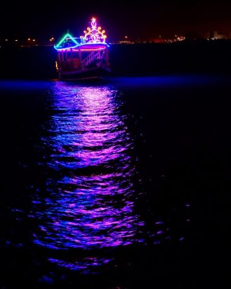 Doha Corniche nighttime city lights dow boat