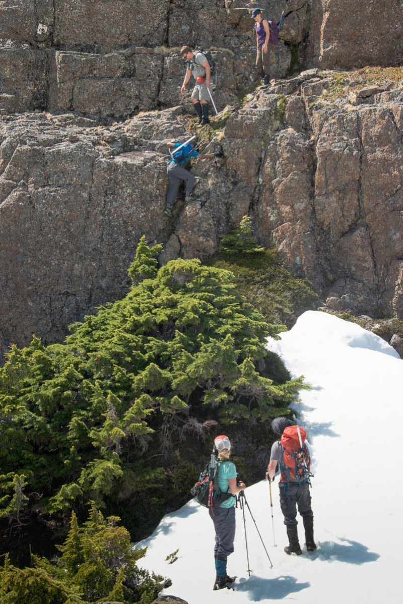 The group scambling down some ledges on their way to Mount Palmerston.