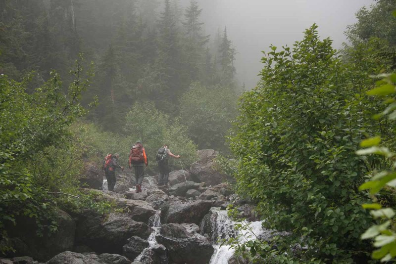 The four Island Mountain Ramblers walking up the stream toward Steamboat Mountain