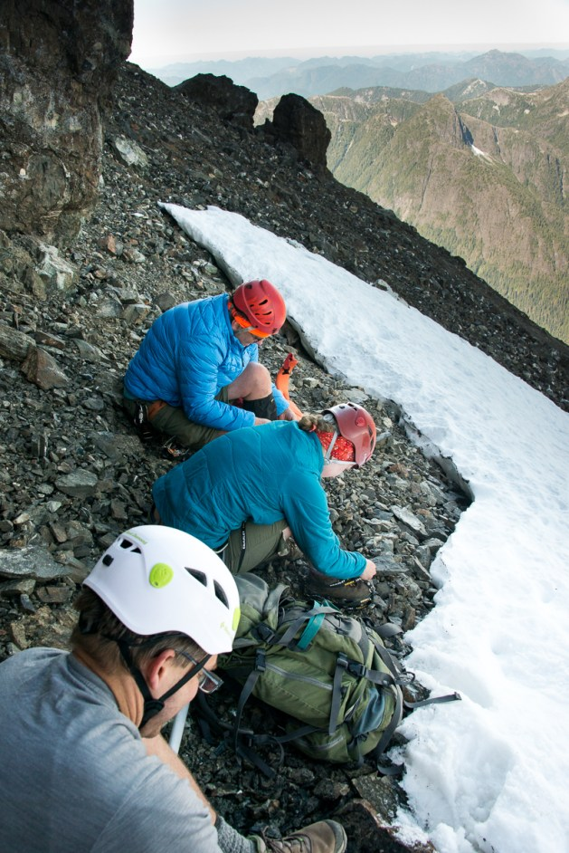 Putting on crampons for the trip up the snowslope.