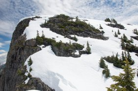 Photograph of a snow covered hill leading to the summit of Mount Heber